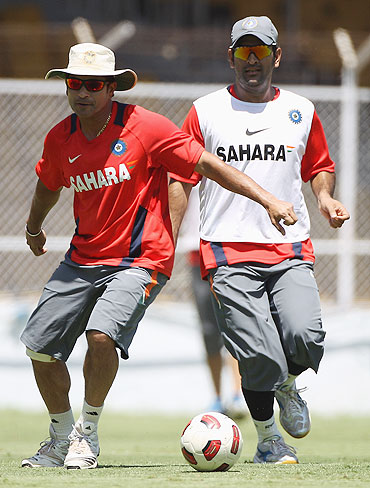 India's Sachin Tendulkar (left) and MS Dhoni (right) play football during a training session