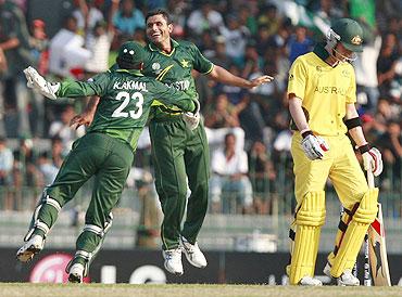 Pakistan's Abdul Razzaq (right) celebrates after taking the wicket of Australia's Michael Clarke