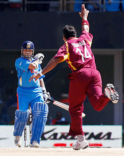 Ravi Rampaul of West Indies celebrates after dismissing Sachin Tendulkar