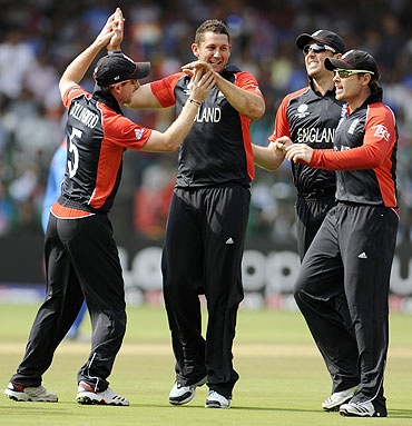 Tim Bresnan is congratulated by teammates after taking wicket of Virender Sehwag