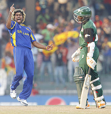 Lasith Malinga (left) celebrates his hat-trick after dismissing Kenya's Shem Ngoche