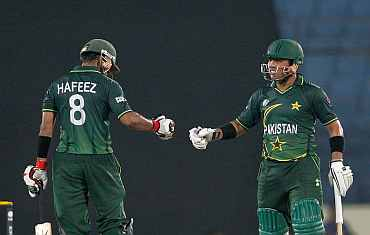 Pakistan openers Kamran Akmal and Mohammad Haffez celebrate after winning their match against West Indies