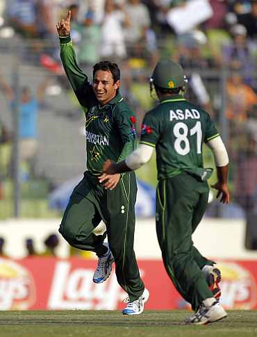 Saeed Ajmal celebrates after picking up a wicket against West Indies