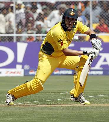 Shane Watson plays a shot during the quarter-final match against India