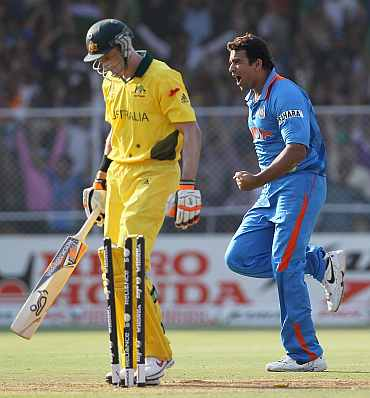 Zaheer Khan celebrates after picking the wicket of Mike Hussey