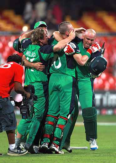 Ireland players celebrate after winning their match against England