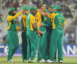 South African players celebrate the dismissal of a wicket