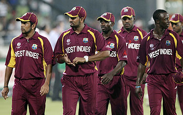 West Indies' players walk off the field after their loss against Pakistan