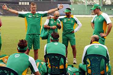 South African coach Corrie van Zyl speaks to South African players during a practice session
