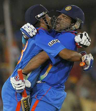 Yuvraj Singh and Suresh Raina celebrate after winning their quarter-final match against Australia