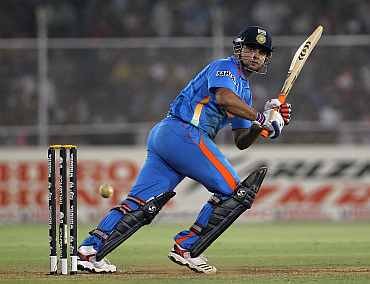 Suresh Raina plays a leg glance during his match against Australia