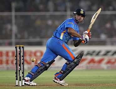 Suresh Raina plays a leg glance during his match against Australia