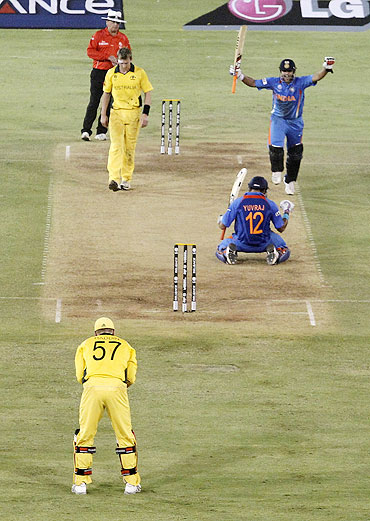 India's Suresh Raina, right, and Yuvraj Singh celebrate after defeating Australia