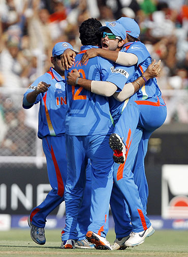 Indian players celebrate the dismissal of Australia's Michael Clarke