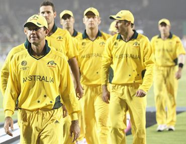 Ricky Ponting leads his team from the field after their loss to India in the World Cup quarter-final