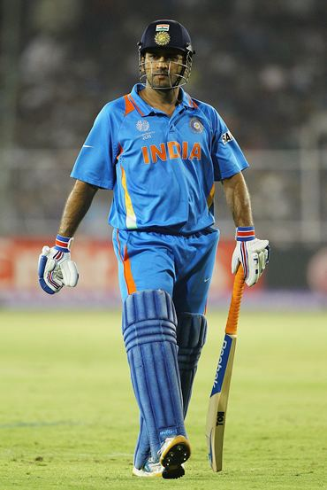 Dhoni walks off after being dismissed in the quarter-final