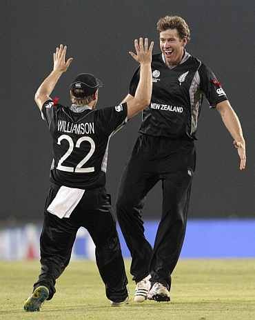 Jacob Oram celebrates after picking up a wicket in Mirpur