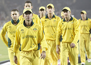 Ricky Ponting leads the Australian team out of the field after their loss to India