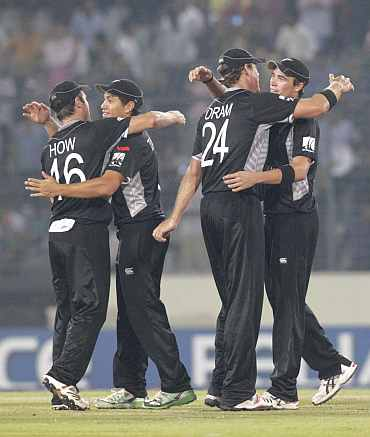 New Zealand players celebrate after winning their quarter-final match against South Africa