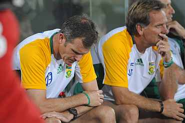 South African coach Corrie van Zyl reacts after losing the match against New Zealand