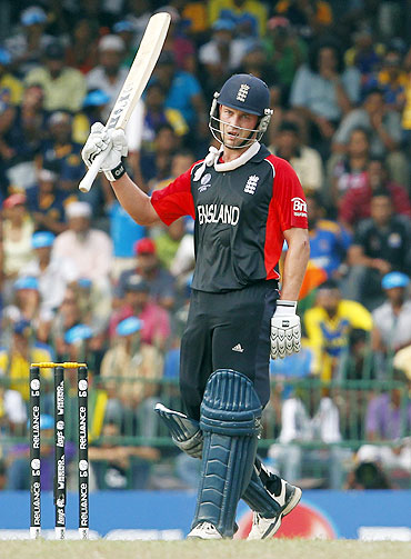 Jonathan Trott raises his bat to celebrate completing a half-century