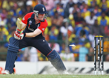 Eoin Morgan of England looks on, as he breaks his bat