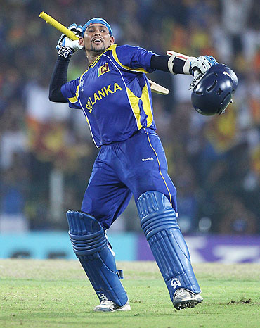 Tillakaratne Dilshan celebrates after scoring a century