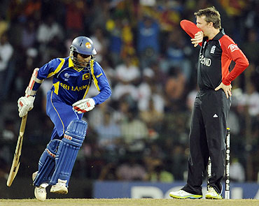 Sri Lanka's Upul Tharanga (left) takes a run past England's Graeme Swann