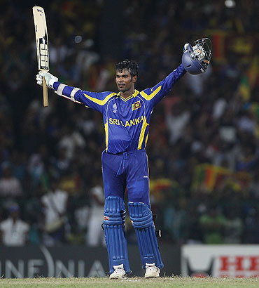Upul Tharanga celebrates after reaching his century