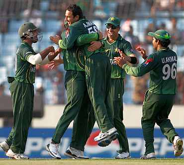 Saeed Ajmal celebrates after picking up a wicket