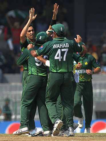 Umar Gul celebrates after picking up a wicket
