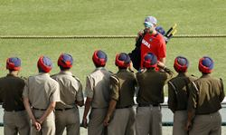 Security personnel take pictures of Yuvraj Singh at Mohali ahead of the India-Pakistan World Cup match