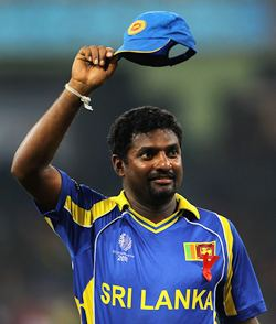 Muralitharan waves to the crowd after New Zealand's innings in the World Cup semi-final against Sri Lanka