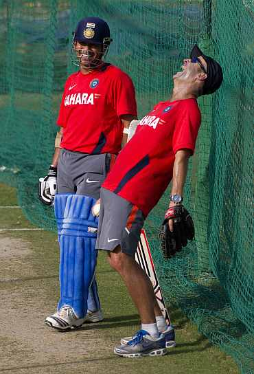 Coach Gary Kirsten laughs along with Sachin Tendulkar during a practice session