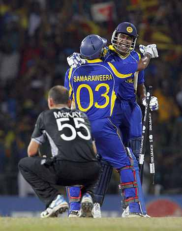 Thilan Sameeraweera celebrates with Mahela Jayawardene after winning their match against New Zealand