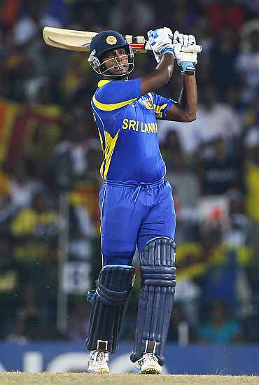 Angelo Mathews hits a six during his semi-final match against New Zealand in Colombo
