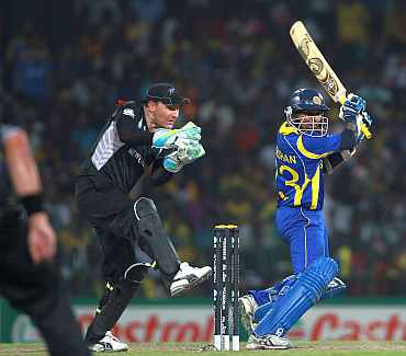 Tillakaratne Dilshan plays a shot during his semi-final match against New Zealand