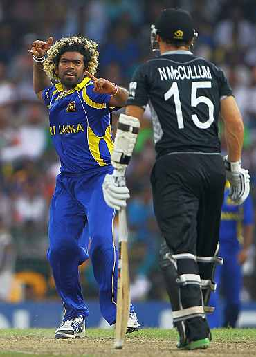 Lasith Malinga celebrats after picking up a wicket during his semi-final match against New Zealand