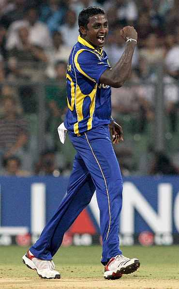 Ajantha Mendis celebrates after picking up a wicket