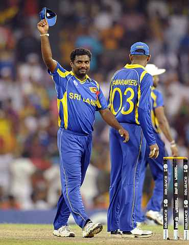 Muttaih Muralitharan celebrates after picking up the last New Zealand wicket