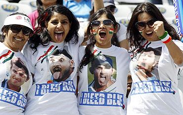 Fans of India pose before the start of the ICC Cricket World Cup 2011 semi-final match between India and Pakistan in Mohali on Wednesday