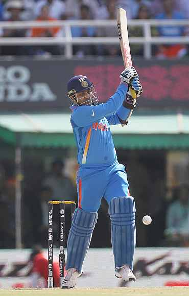 India's Virender Sehwag plays a shot during his semi-final match against Pakistan