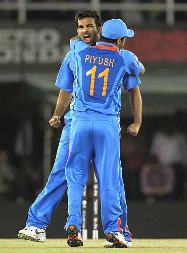 Zaheer Khan celebrates after picking the wicket of Kamran Akmal