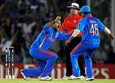 Yuvraj Singh celebrates after dismissing Younis Khan
