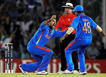 Yuvraj Singh celebrates after dismissing Younis Khan