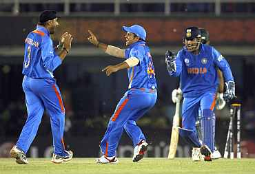 The Indian team celebrates after defeating Pakistan in the semi-final