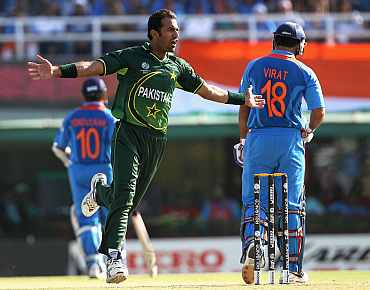 Wahab Riaz celebrates after dismissing Virat Kohli