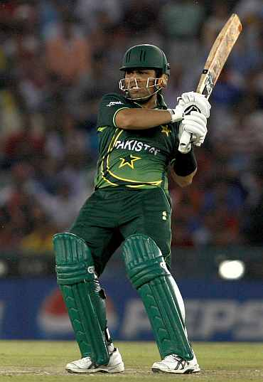 Kamran Akmal plays a shot during his semi-final match against India