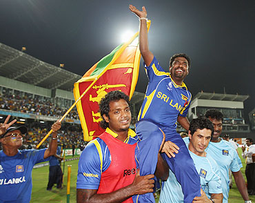Muttiah Muralitharan of Sri Lanka acknowledges the crowd after playing his last match in Sri Lanka on Tuesday
