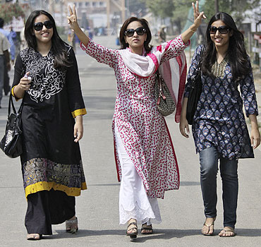 Pakistan fans arrive in India through the India-Pakistan joint check post at the Wagah border